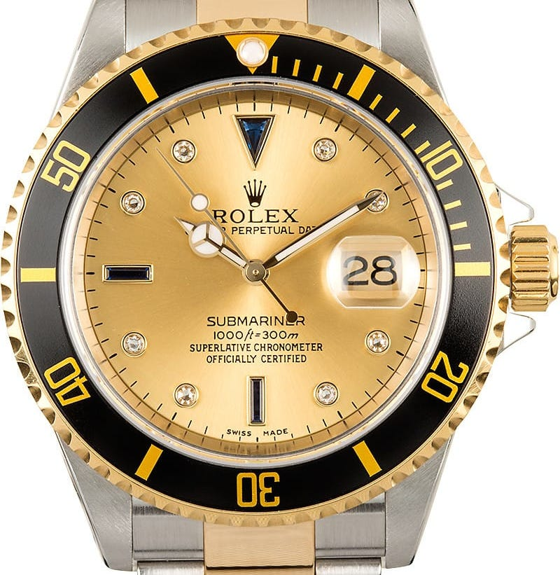 Rolex Submariner ref. 16613 with black bezel and champagne Serti dial.